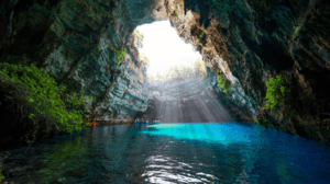 Melissani lake,  the underground lake. Take a boat ride and experience the magic